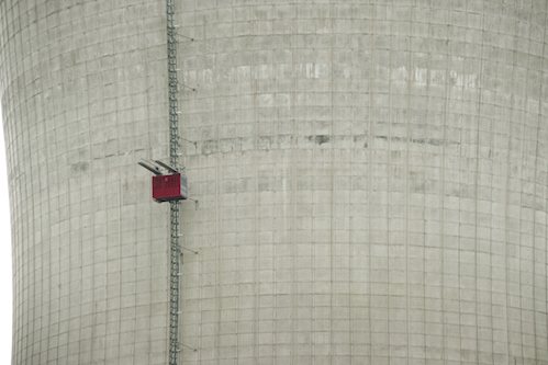 Constructing A Cooling Tower with red elevator on construction site of a new power station.